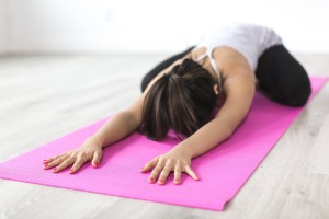 Girl stretching on mat